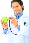 4168624-young-caucasian-doctor-smile-checking-the-health-of-green-apple-concept-for-healthy-eating